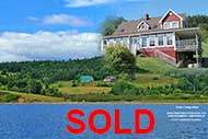 Majestic Farmhouse overlooking the Bras d`Or Lakes on up to 167 acres land and 620 m waterfront for sale on Cape Breton Nova Scotia