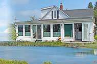 Renovated Farmhouse with waterfront at Bras d'Or Lake on 11 acres for sale on Cape Breton Island, Nova Scotia, Canada