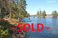 9.2 acre land with over 140 m waterfront at River Denys just minutes to the mouth into Bras d'Or Lake on Cape Breton Island, Nova Scotia, Canada