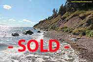 13.5 acre Property with ca 200 m shore front on the open Bras D`Or Lake for sale on Cape Breton Island, Nova Scotia, Canada